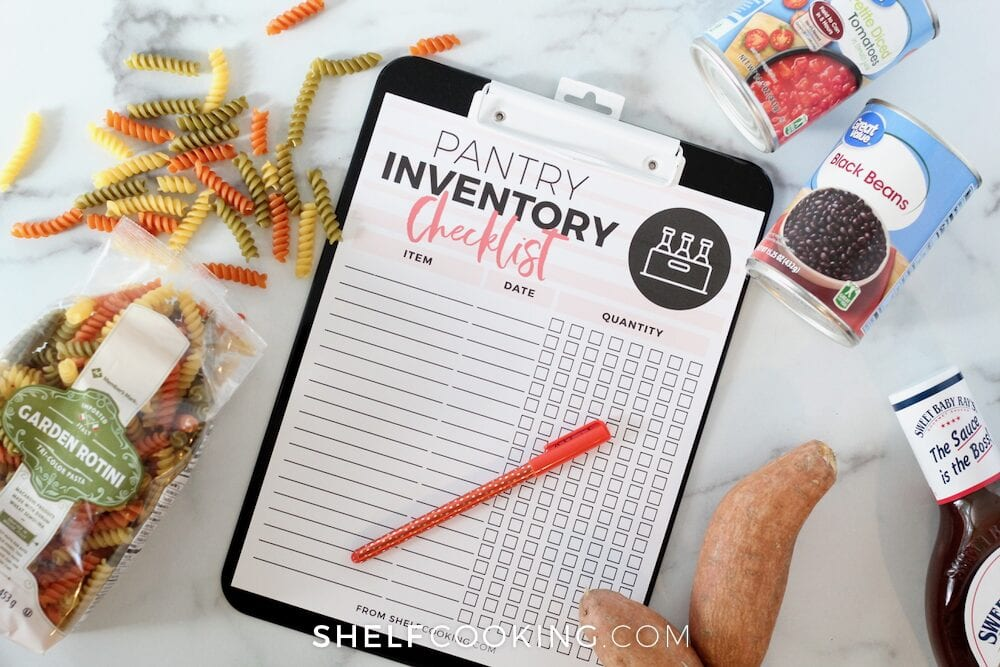 Pantry inventory checklist printable on a counter, from Shelf Cooking