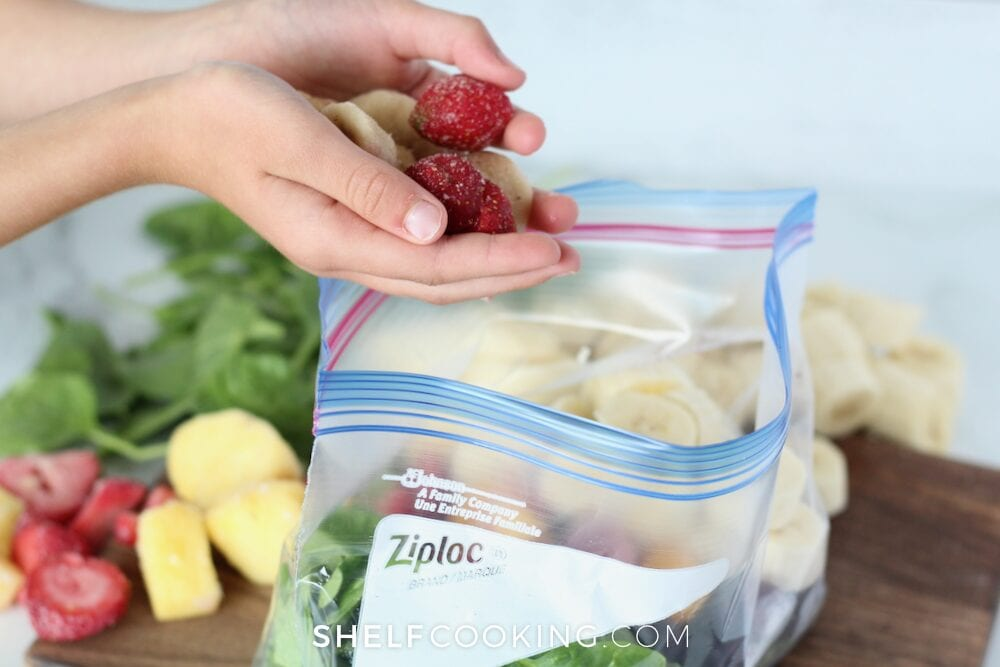 Adding fruit to a freezer bag, from Shelf Cooking