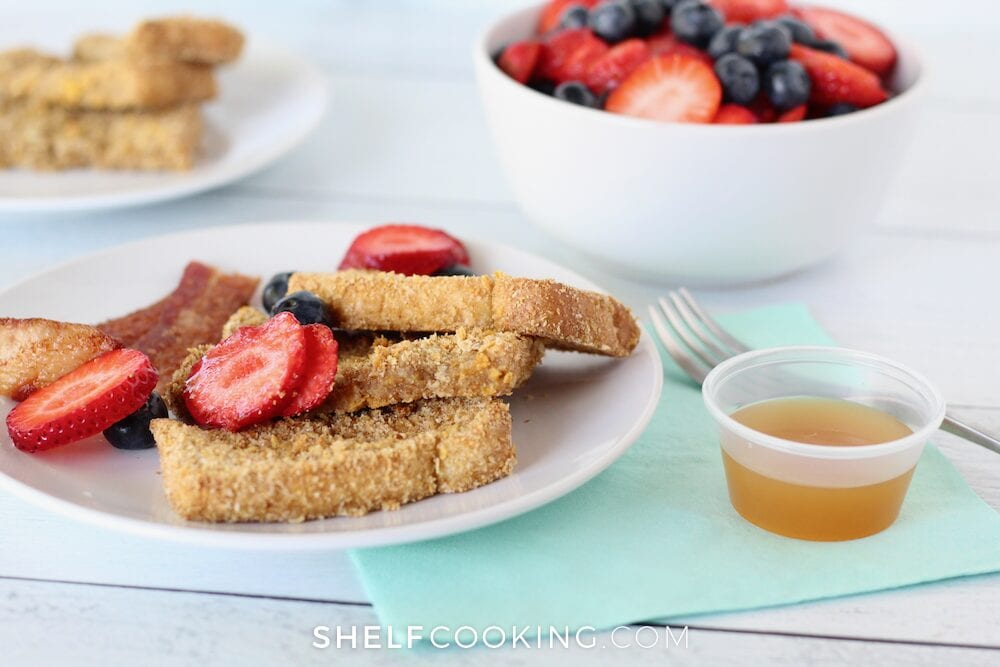 Crunchy French toast sticks on a plate, from Shelf Cooking.