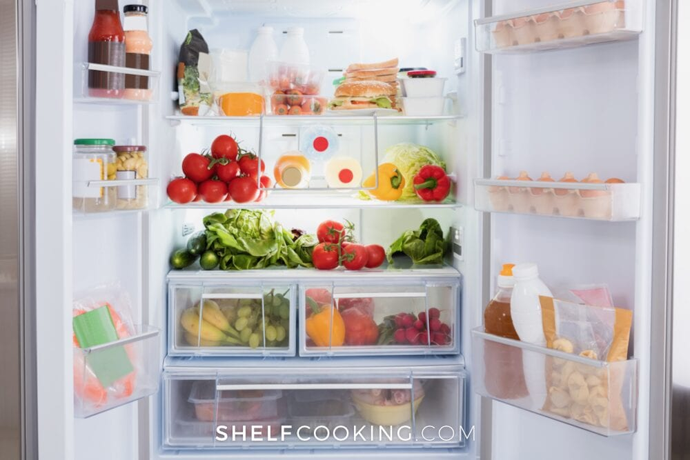 Open refrigerator full of food, from Shelf Cooking