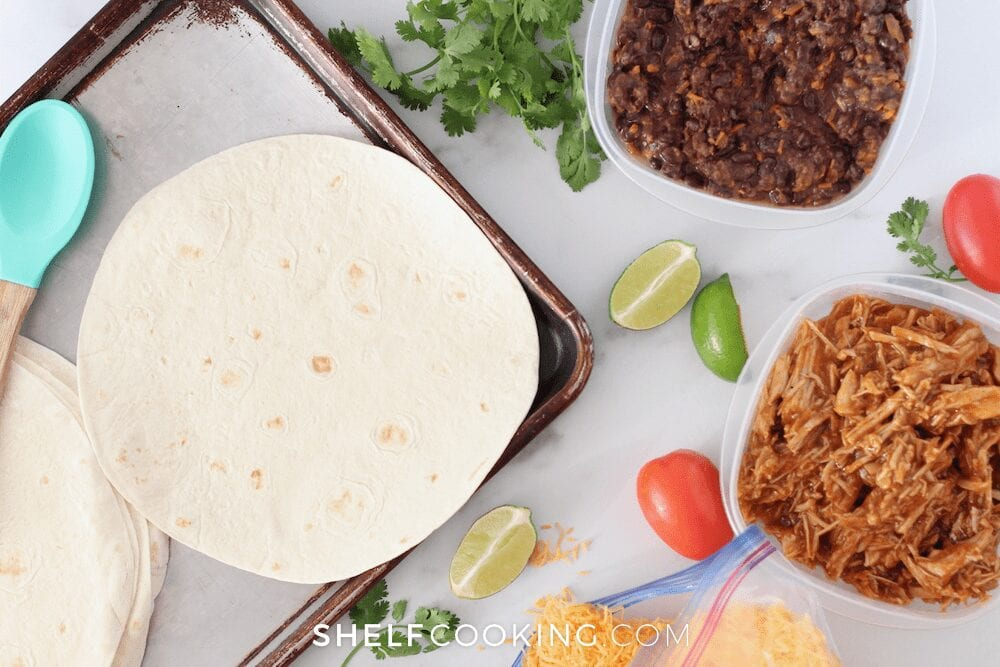 Leftovers, tortillas, and cheese on a counter, from Shelf Cooking