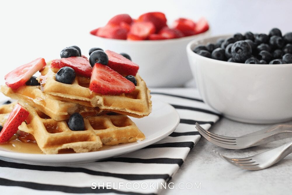 Waffles, blueberries, and strawberries on a plate, from Shelf Cooking