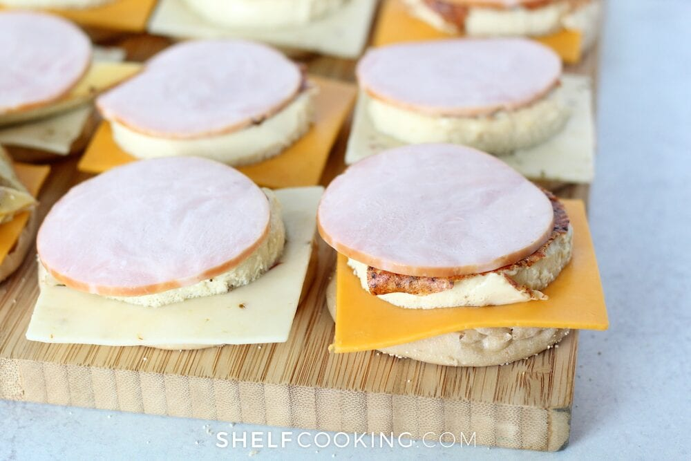 Assembling breakfast egg sandwich on a cutting board, from Shelf Cooking