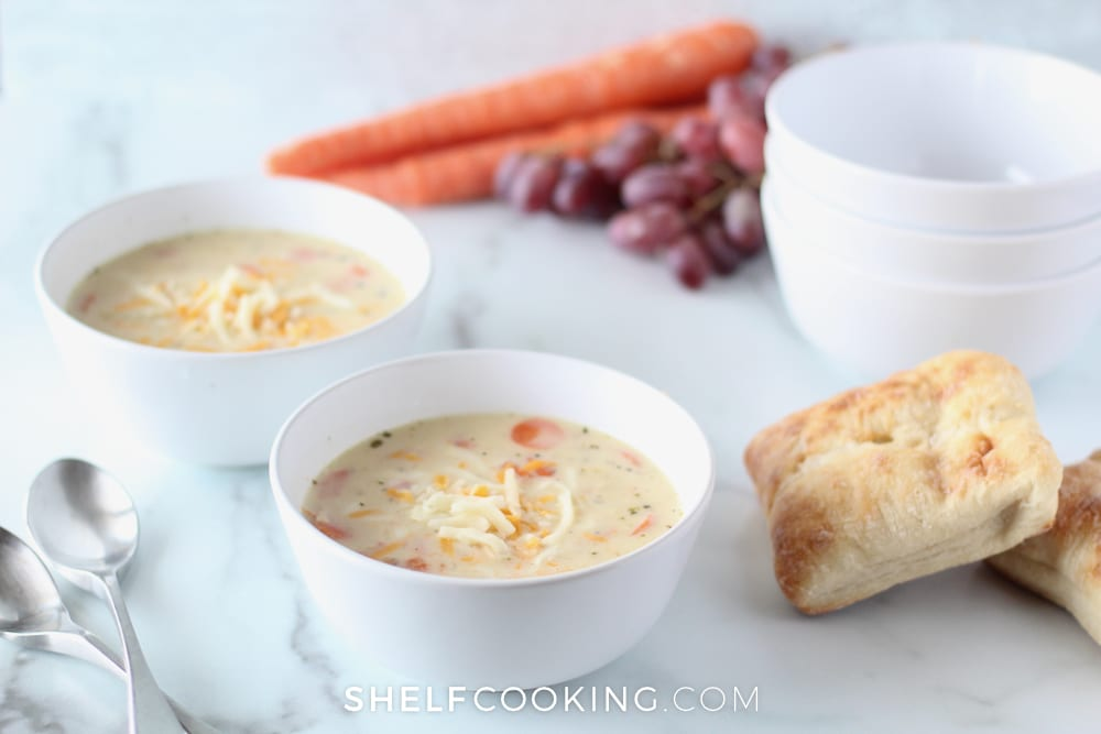 This easy creamy chicken soup is so easy and delicious, even the pickiest eaters will love it! Recipes from ShelfCooking.com