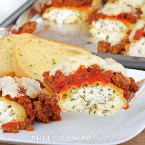 Lasagna roll ups = an easy dinner idea that you can double, make extra, and freeze for busy weeknight meals! Family favorite recipes from ShelfCooking.com