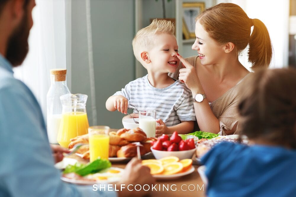 Family eating at the dinner table after a meal plan for kids, from Shelf Cooking