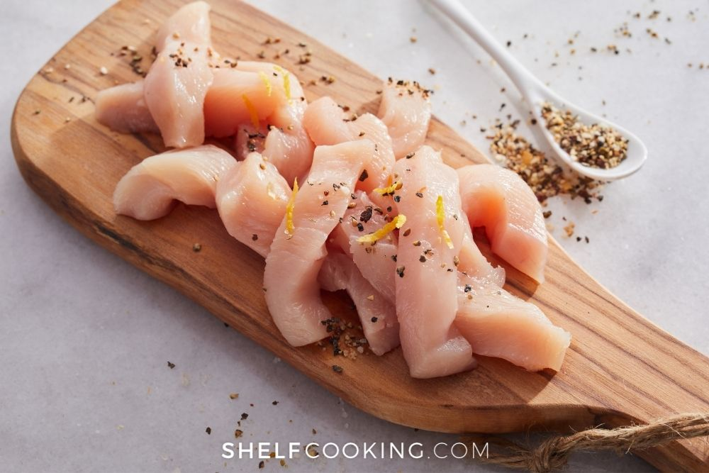 raw chicken on a cutting board, from Shelf Cooking