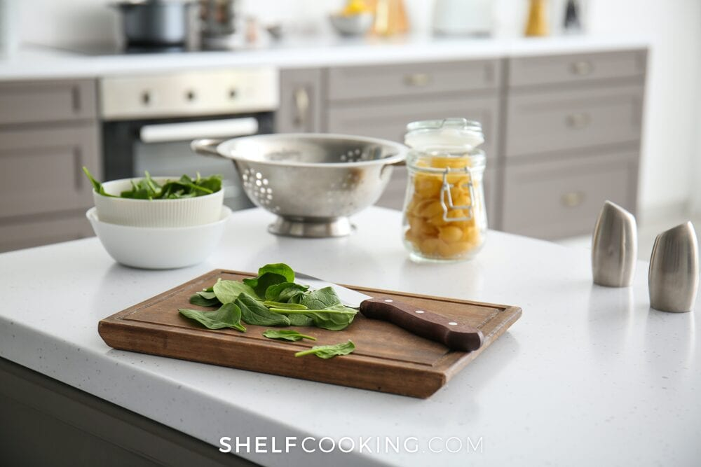 Greens on a cutting board, from Shelf Cooking
