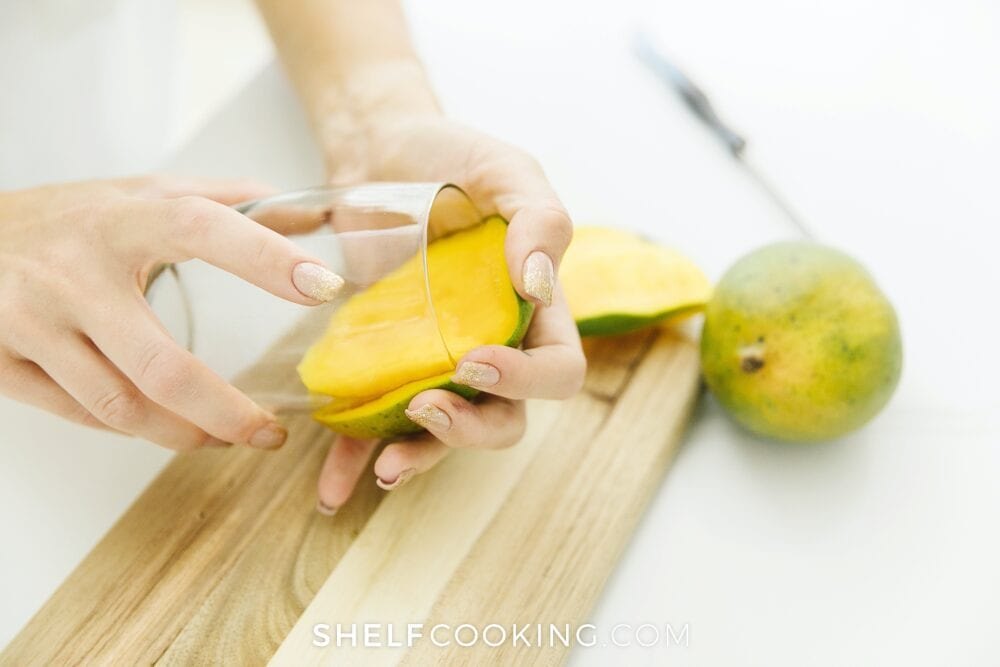 Peeling a mango with a glass, from Shelf Cooking