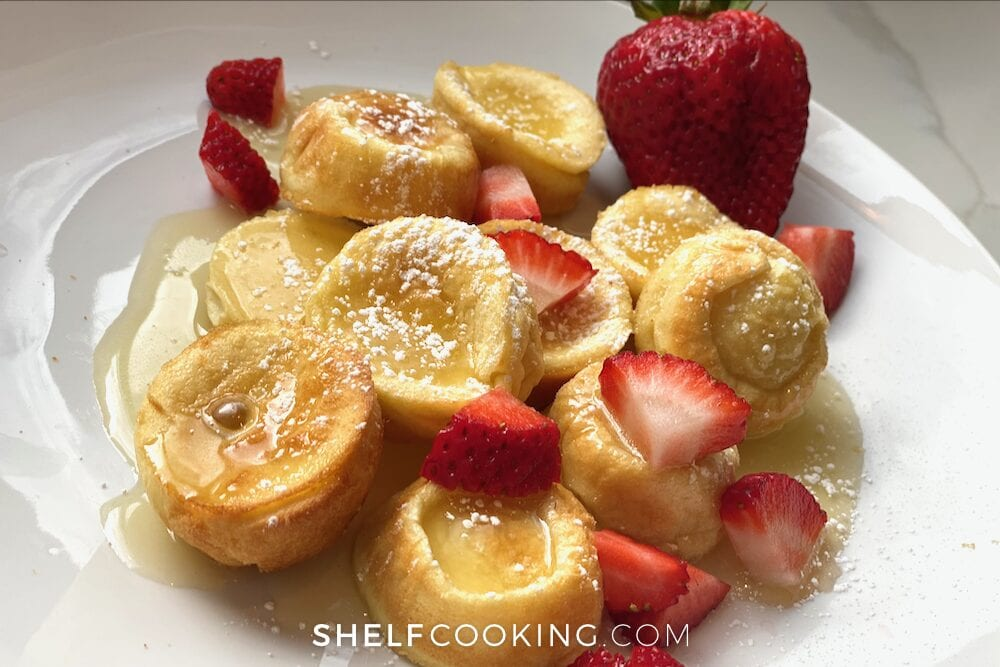 German pancakes and strawberries on a plate, from Shelf Cooking