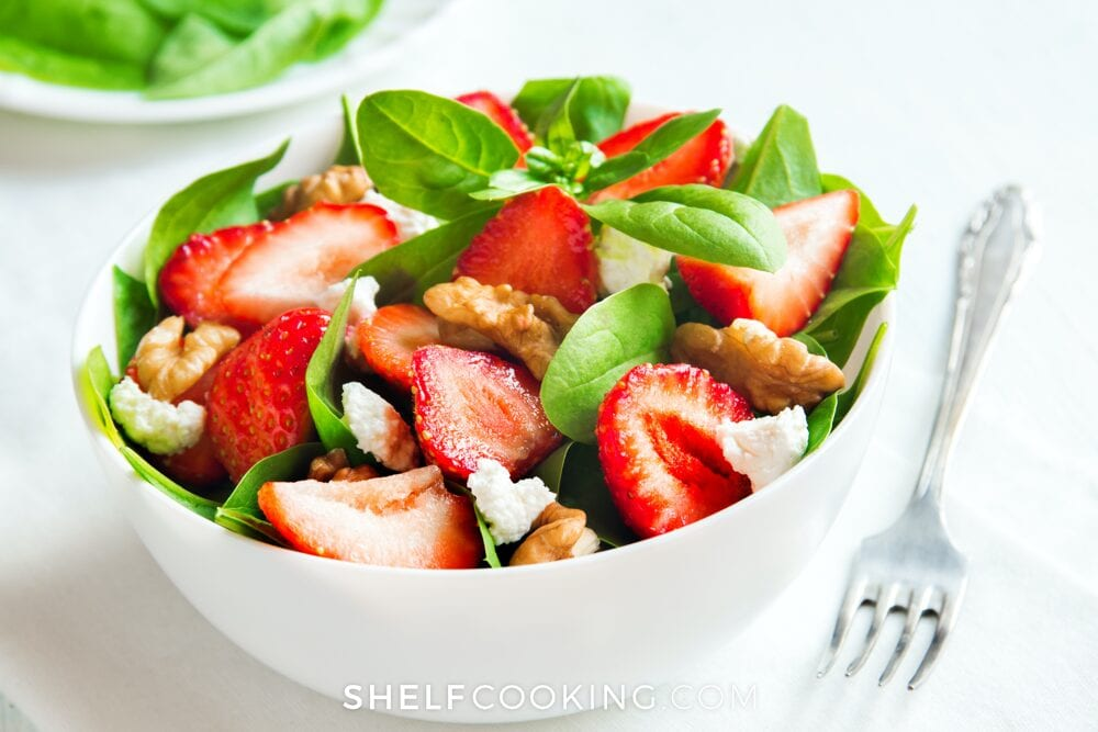 summer strawberry spinach salad in a bowl, from Shelf Cooking