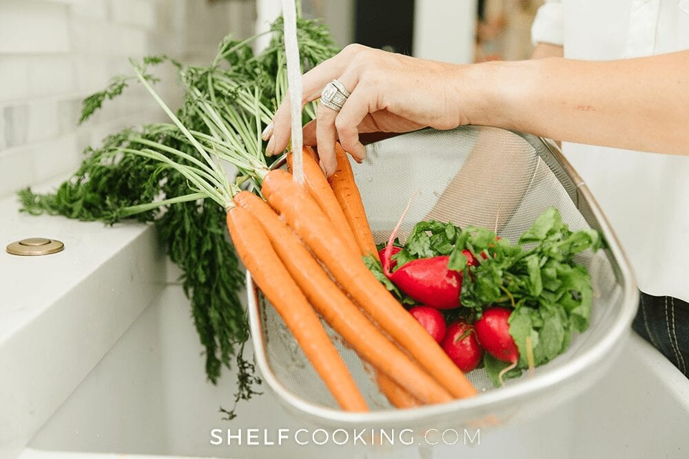 rinsing vegetables in a colander, from Shelf Cooking