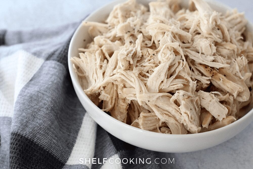 Shredded chicken in a bowl, from Shelf Cooking