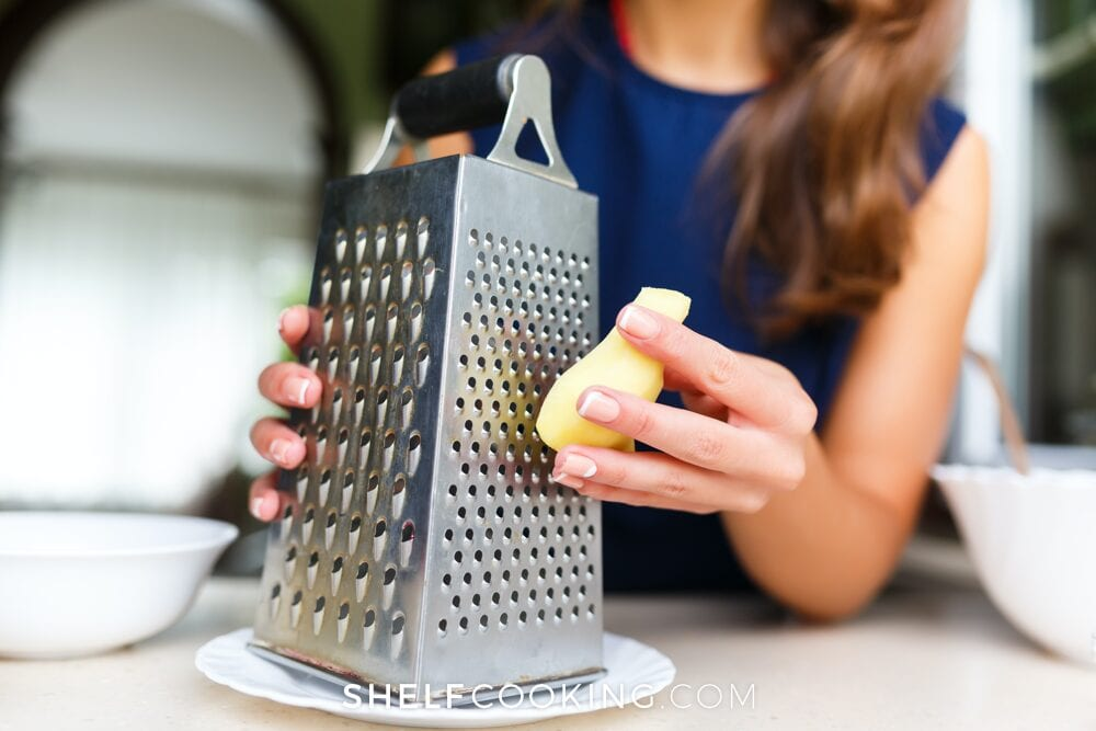 Woman grating vegetable, from Shelf Cooking