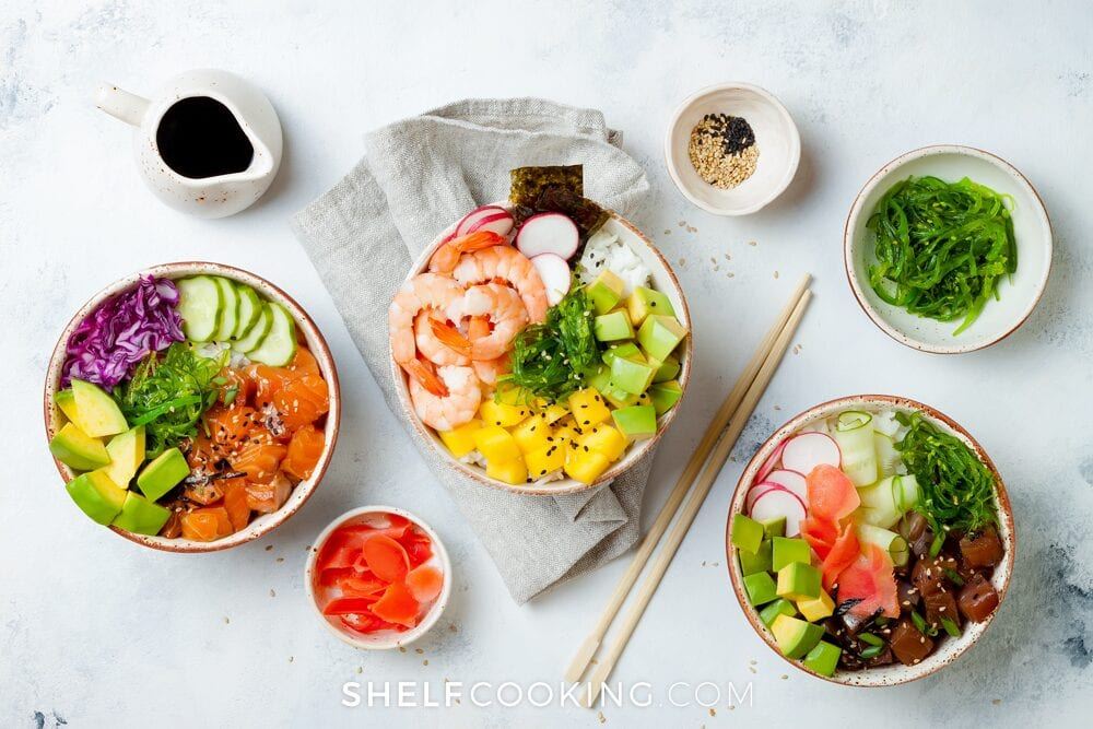 Multiple rice bowl recipes in bowls on a counter, from Shelf Cooking