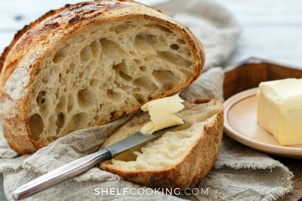 rustic bread with butter and a knife from Shelf Cooking
