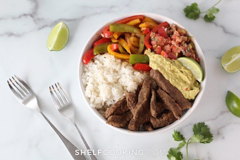 Steak with rice, peppers, pico de gallo, and guacamole, from Shelf Cooking