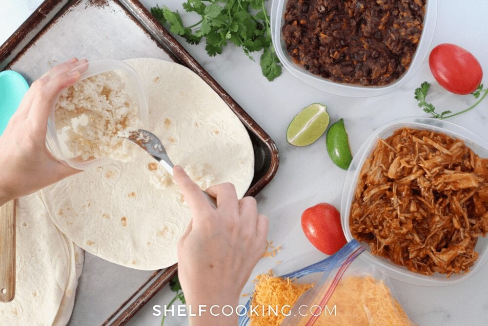 Hands adding leftovers to a tortilla on a sheet pan, from Shelf Cooking