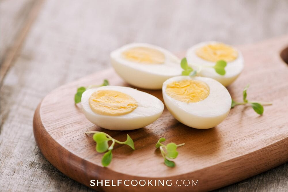 Hard-boiled eggs on a wooden cutting board, from Shelf Cooking