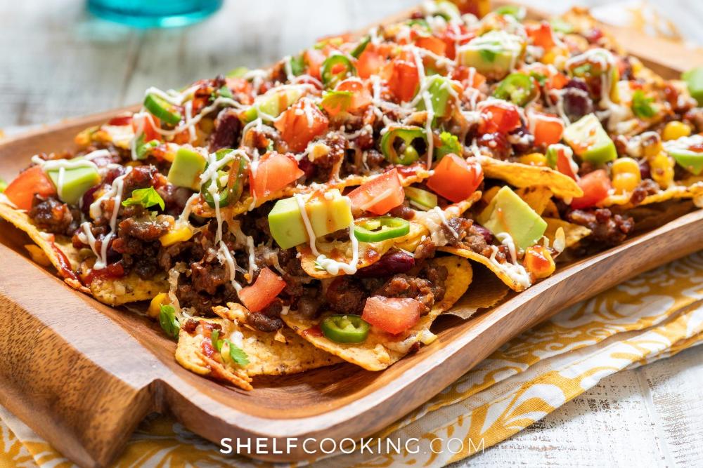 wooden platter of homemade nachos, from Shelf Cooking