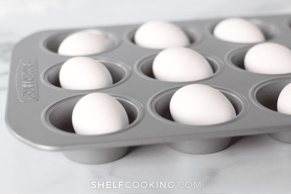 Eggs in a muffin pan, ready to go into the oven to bake, from Shelf Cooking