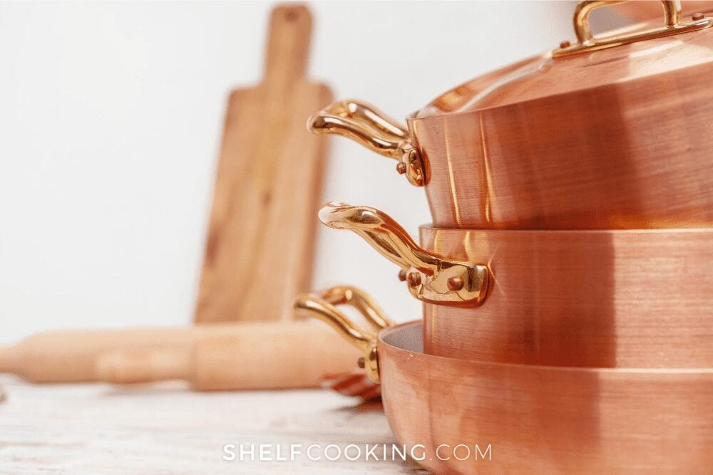 Stack of three copper pans, from Shelf Cooking