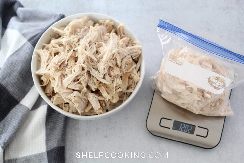 Instant Pot shredded chicken in a baggie on a scale, from Shelf Cooking