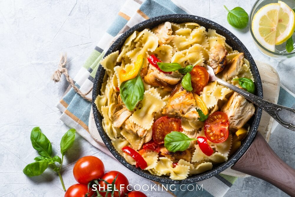 Pasta, chicken, and tomatoes in a skillet, from Shelf Cooking
