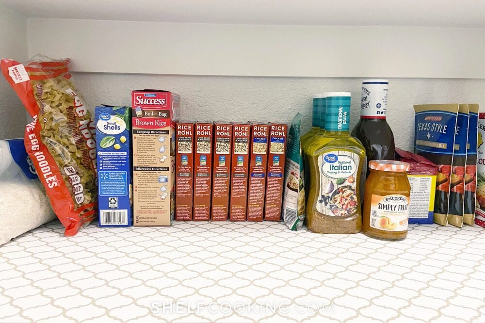 Pasta, rice, and condiments in a pantry, from Shelf Cooking