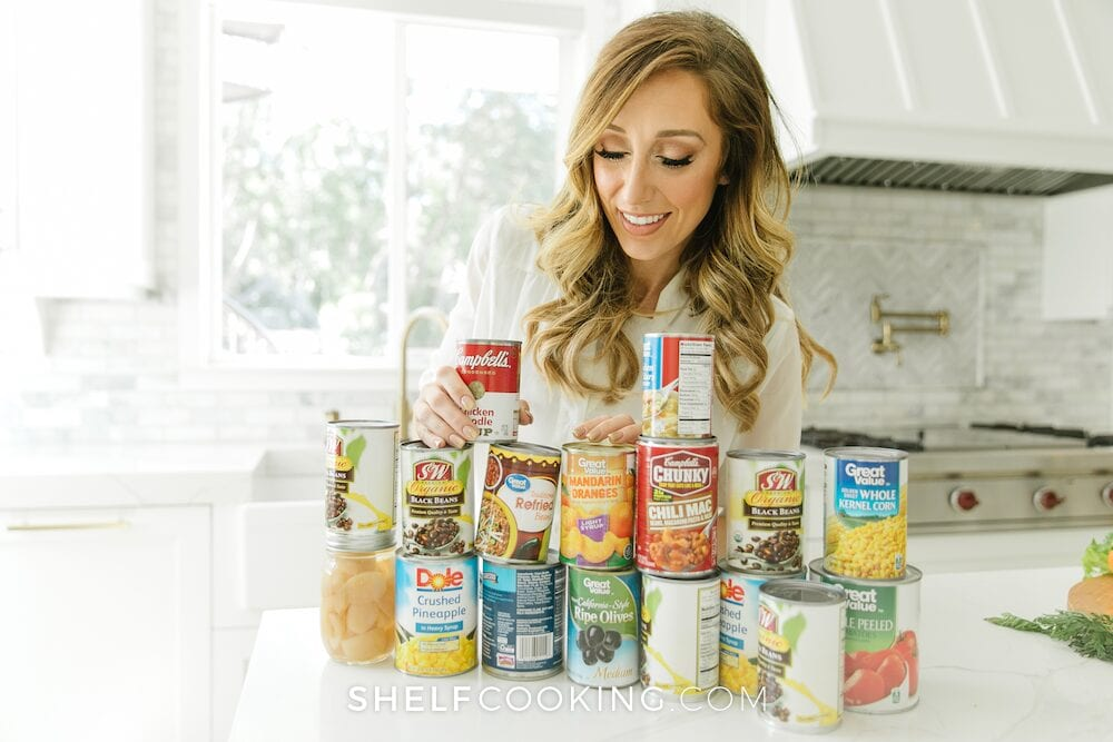 Jordan stacking canned goods from Stocktober, from ShelfCooking.com