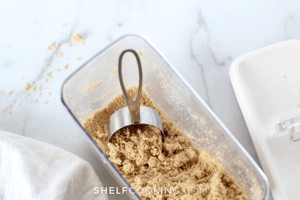 glass dish filled with brown sugar and measuring cup, from Shelf Cooking