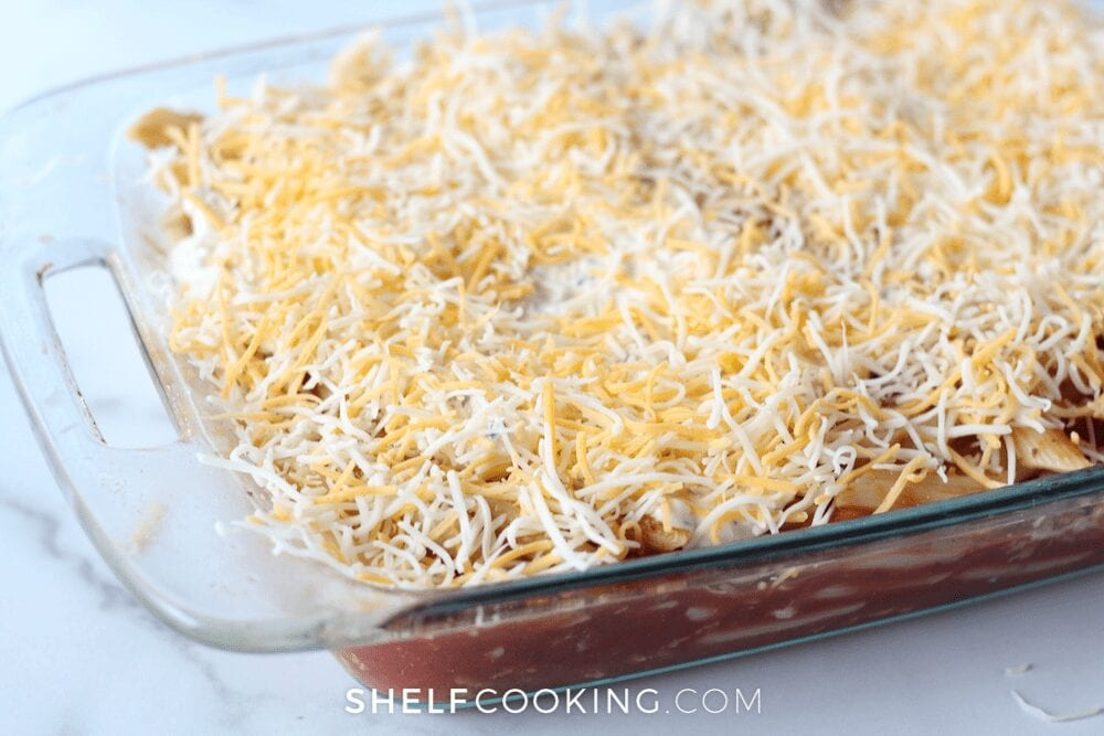 pasta dish topped with shredded cheddar cheese, from ShelfCooking.com