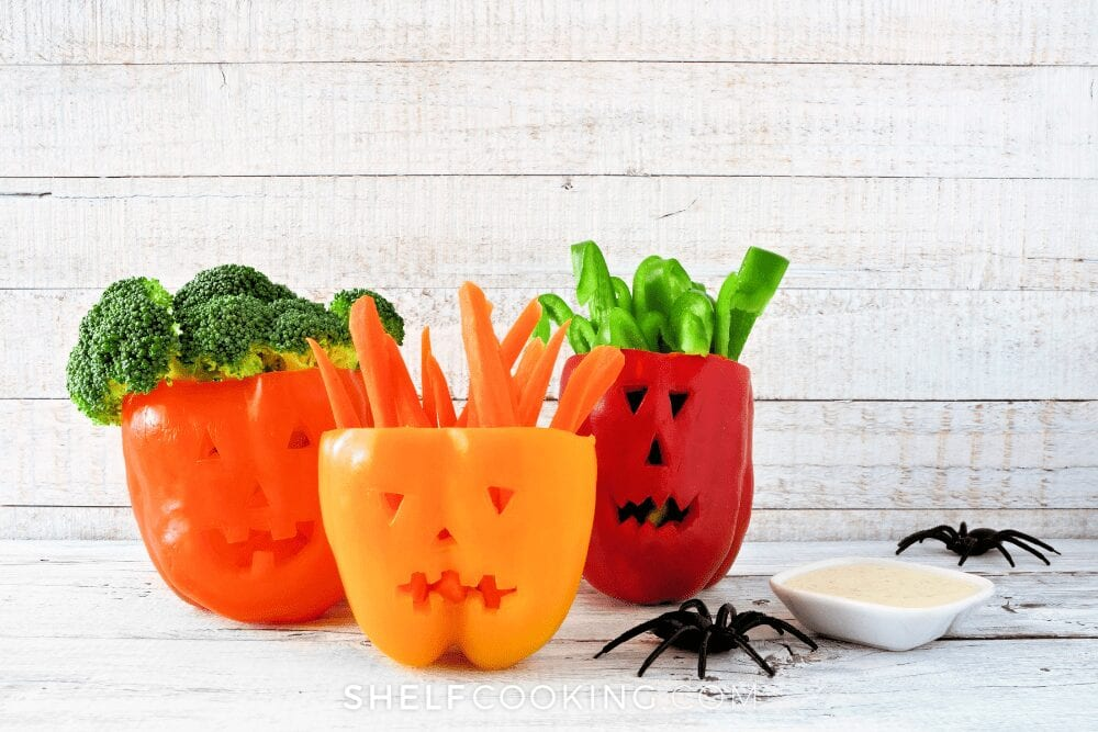 Peppers carved like jack-o-lanterns, from Shelf Cooking