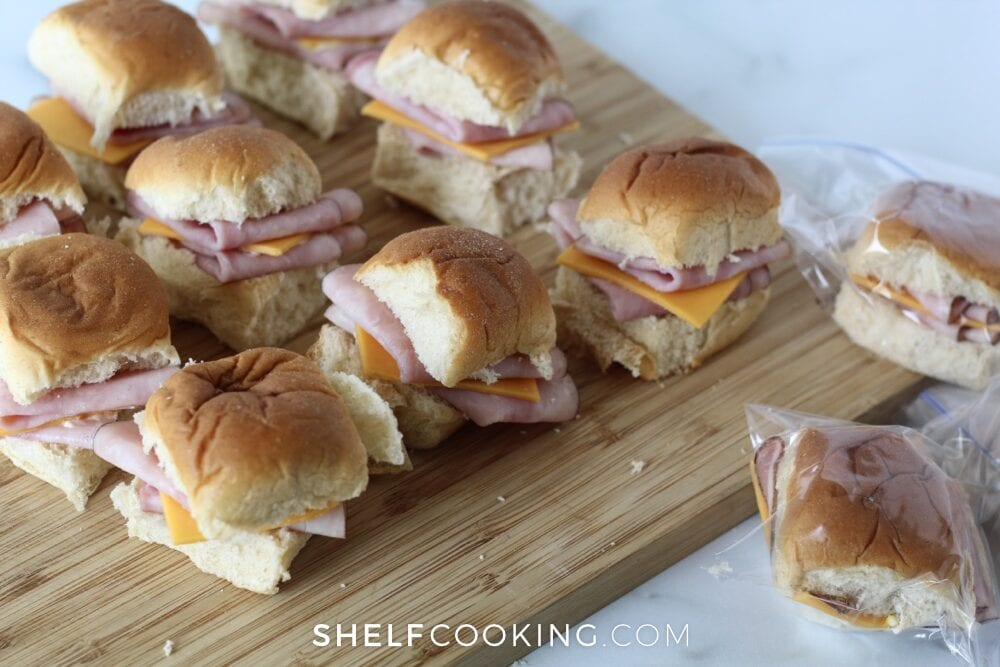Ham and cheese sandwiches on a cutting board, from Shelf Cooking