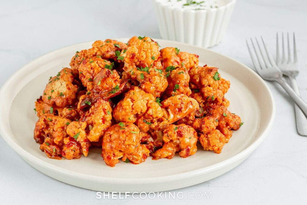 plate of buffalo cauliflower on white background, from Shelf Cooking