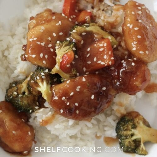 white bowl of asian sesame chicken, from Shelf Cooking