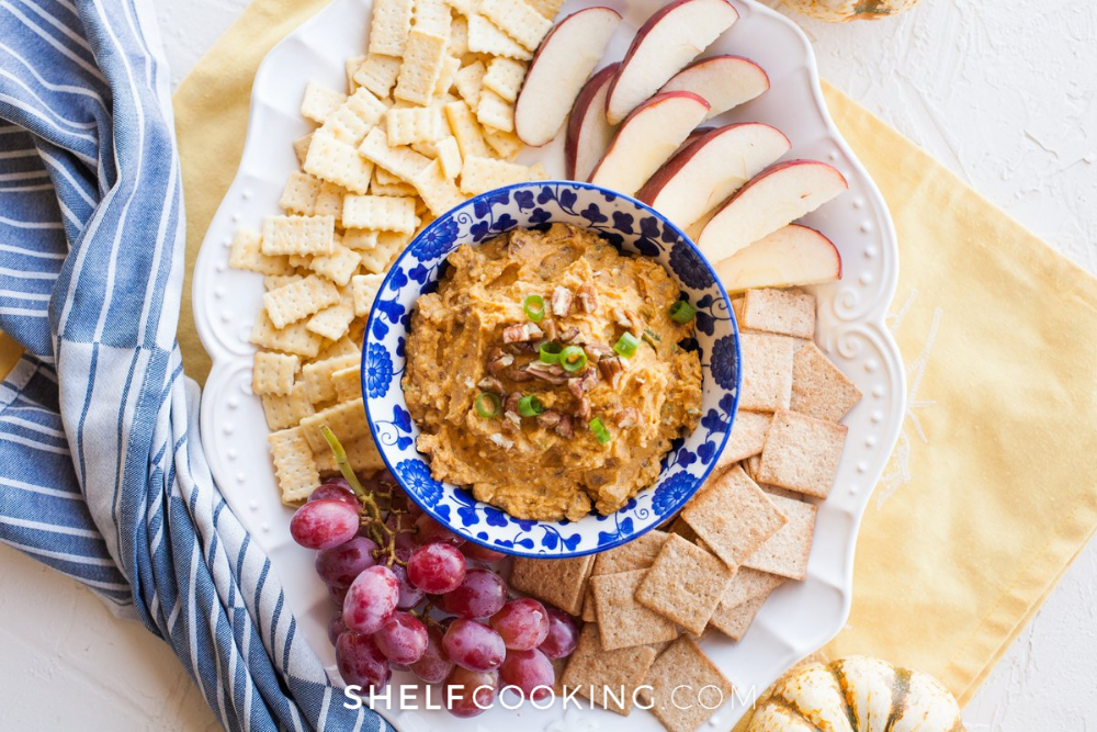 a plate of pumpkin dip with fruit and crackers, from ShelfCooking.com