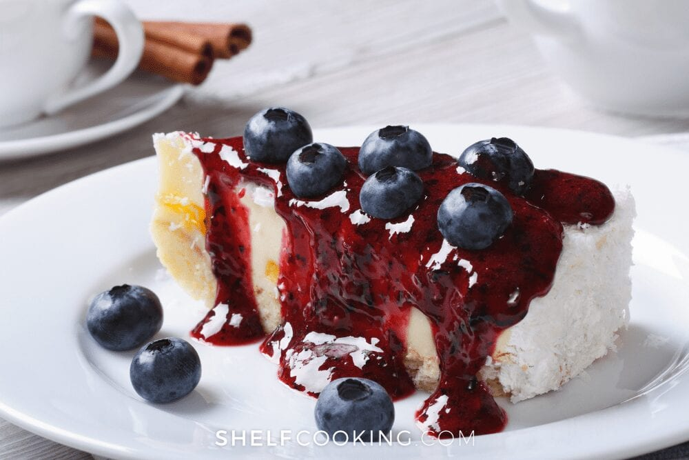 Blueberry cheesecake on a white plate from Shelf Cooking