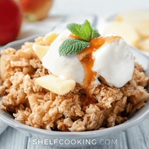 white bowl of apple crisp with ice cream, from Shelf Cooking