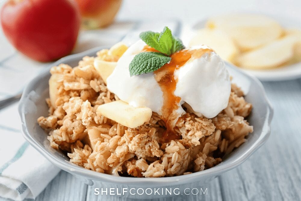 bowl of apple crisp, topped with ice cream, from Shelf Cooking