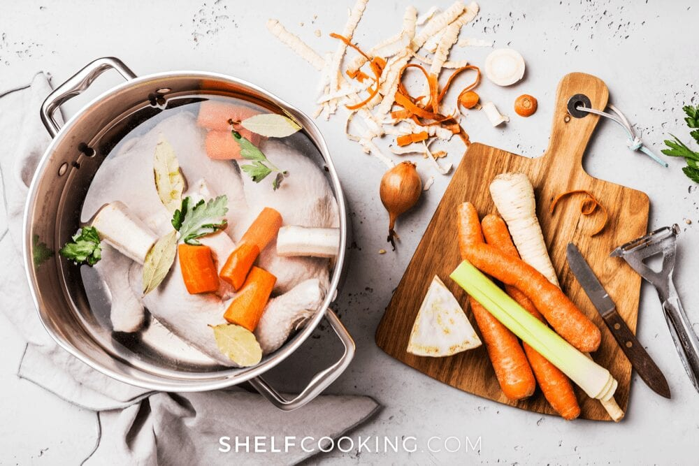 pot of carrots and celery with broth, from Shelf Cooking