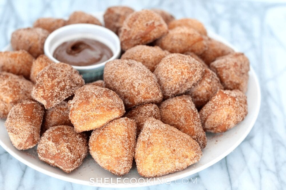 a plate of donut holes and chocolate sauce, from Shelf Cooking