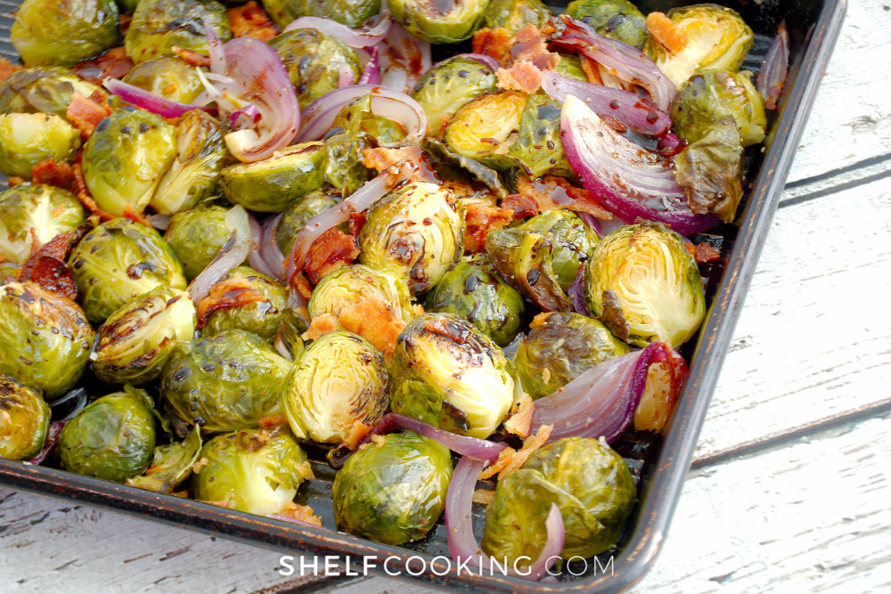 a sheet pan of roasted Brussel sprouts with bacon, from Shelf Cooking.