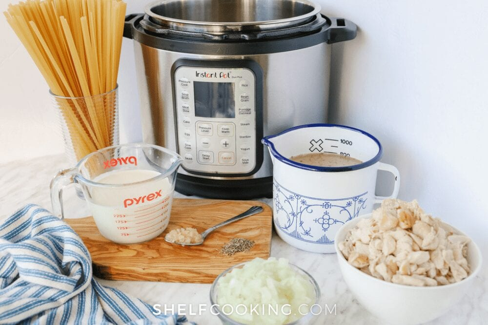instant pot, pasta, and ingredients on countertop, from Shelf Cooking