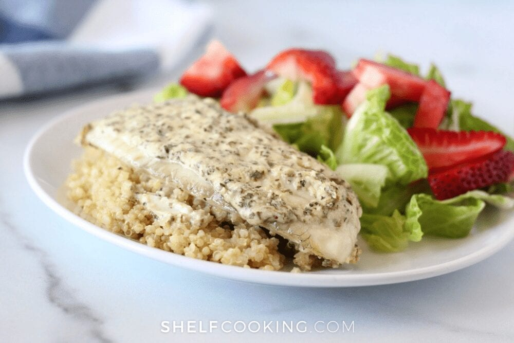 plate of fish, quinoa, and salad, from Shelf Cooking