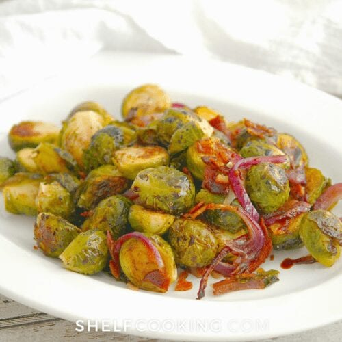 roasted Brussel sprouts on a white plate, from Shelf Cooking