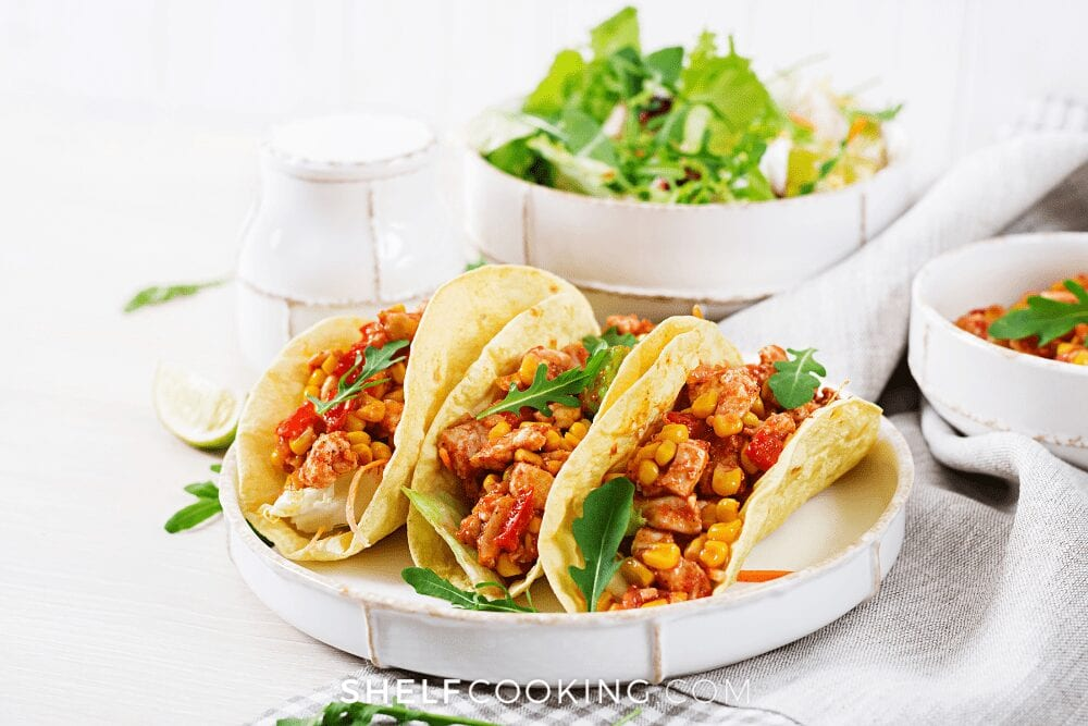 plate of chicken tacos with salad, from Shelf Cooking