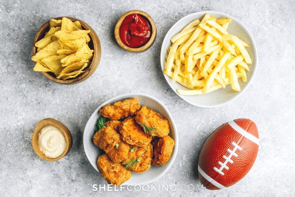 a variety of game day snacks including chicken nuggets, from Shelf Cooking