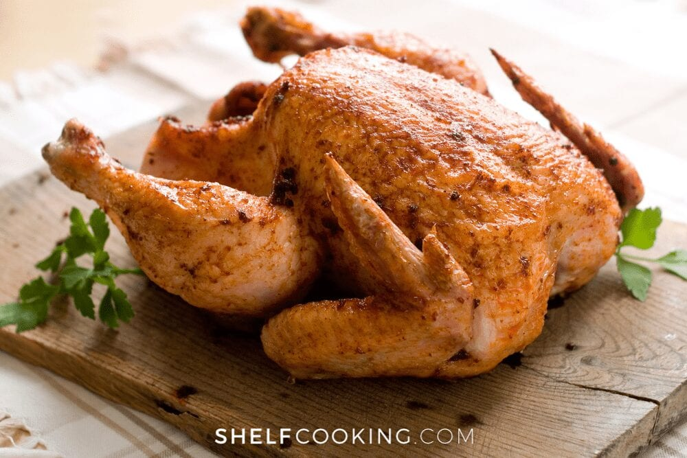 whole rotisserie chicken on cutting board, from Shelf Cooking