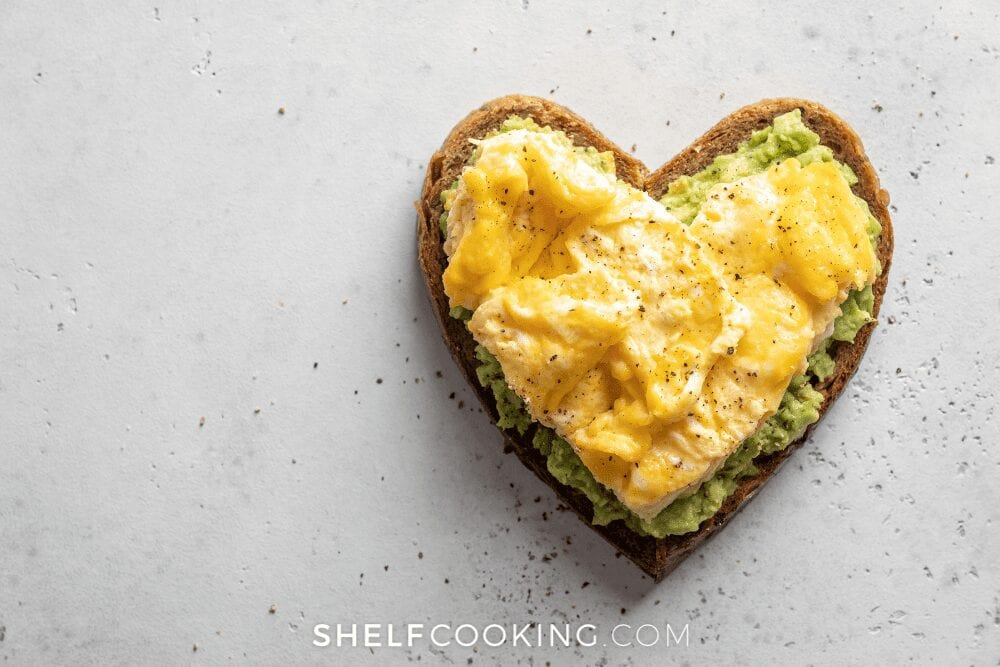 heart shaped avocado toast with scrambled eggs, from Shelf Cooking